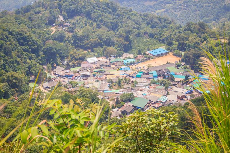 Doi Pui's Hmong ethnic hill-tribe village, aerial view from the. Cliff with green forest on the mountain background. Doi Pui Hmong tribal village is royalty free stock image
