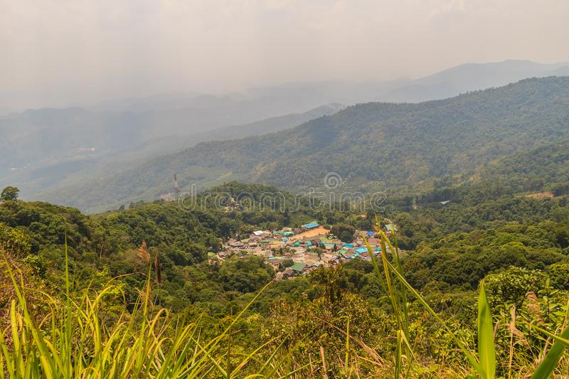 Doi Pui's Hmong ethnic hill-tribe village, aerial view from the. Cliff with green forest on the mountain background. Doi Pui Hmong tribal village is stock photography
