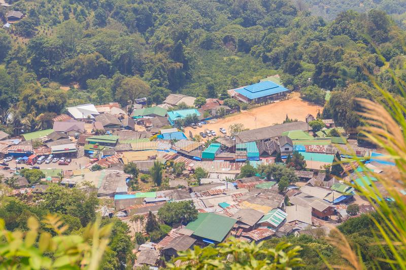 Doi Pui's Hmong ethnic hill-tribe village, aerial view from the. Cliff with green forest on the mountain background. Doi Pui Hmong tribal village is stock photo