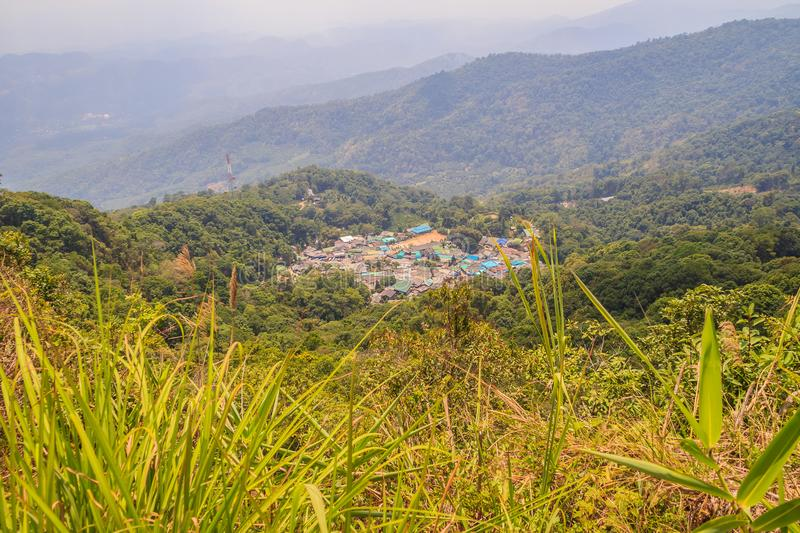 Doi Pui's Hmong ethnic hill-tribe village, aerial view from the. Cliff with green forest on the mountain background. Doi Pui Hmong tribal village is stock image