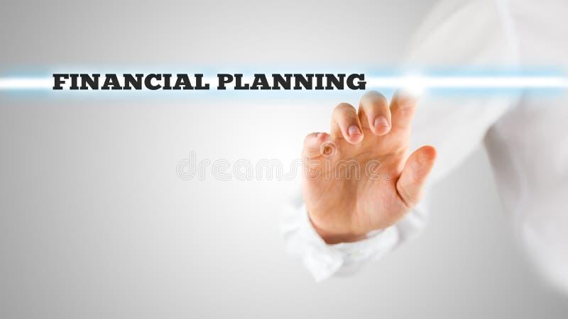 Doigt accentuant des mots de planification financière images libres de droits