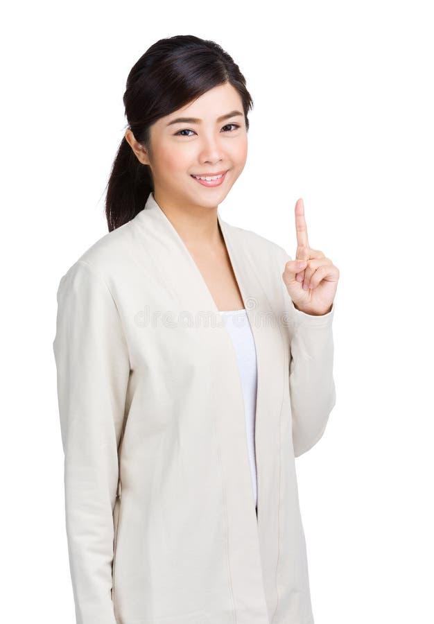 Doigt de femme montrant un signe photographie stock libre de droits
