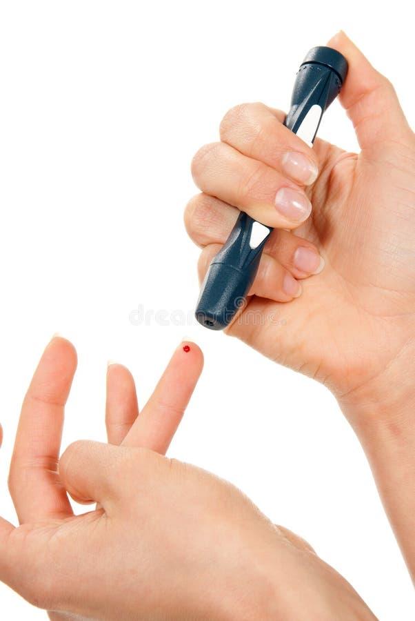 Doigt de piqûre de bistouri de diabète pour la mesure de sang images libres de droits