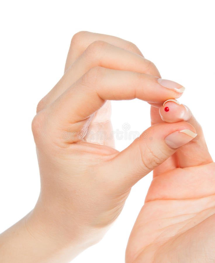 Doigt de piqûre de main de diabète et petits spécimens de sang pour le glucose images libres de droits