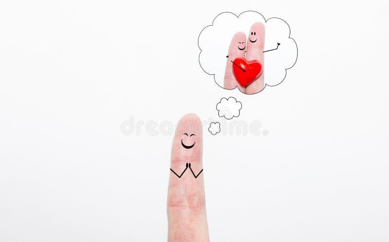 Doigt rêvant de l'amour romantique au jour du ` s de valentine photo stock