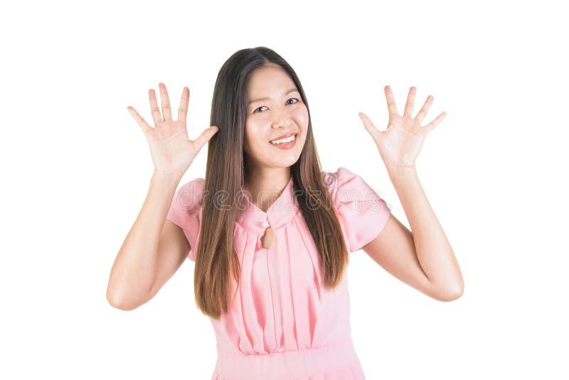 Doigts asiatiques de sourire heureux de l'exposition dix de jeune femme de sa main photos libres de droits
