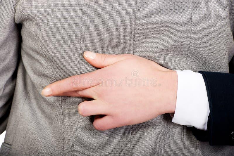 Doigts menteur de main de femme d'affaires faux croisés photos libres de droits