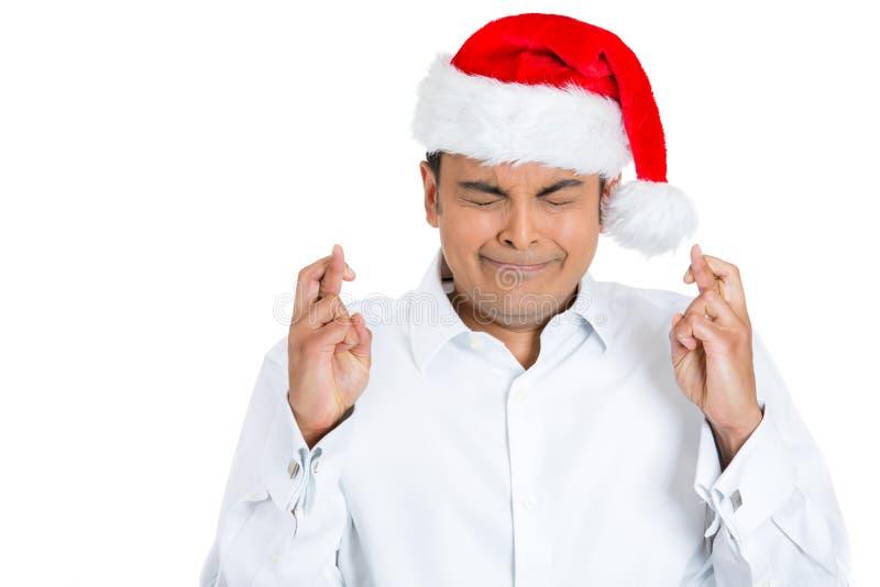 Doigts tendus d'un homme de Noël croisés image stock