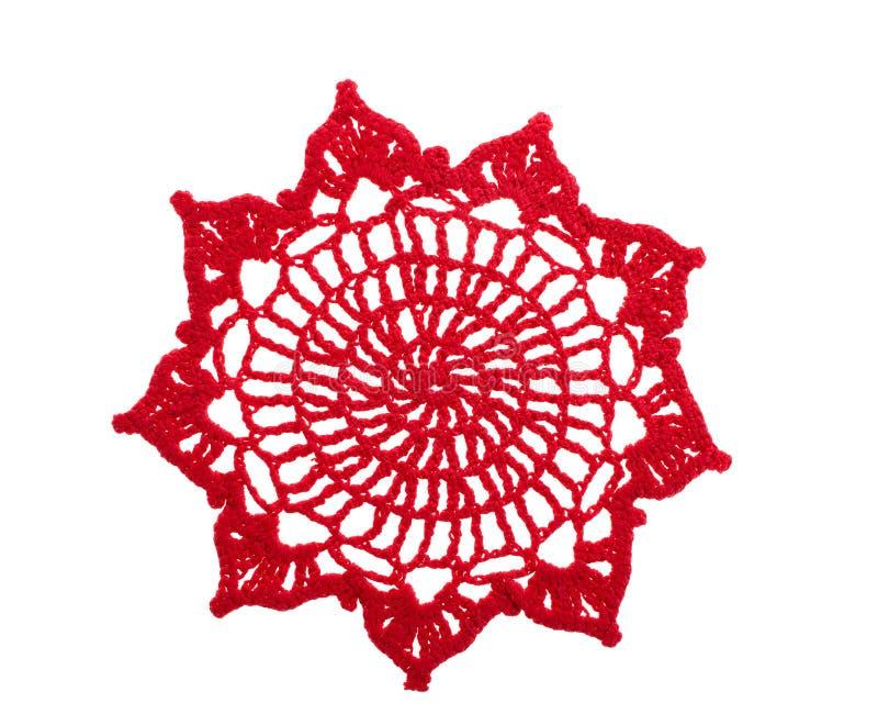 Doily rosso del crochet immagini stock