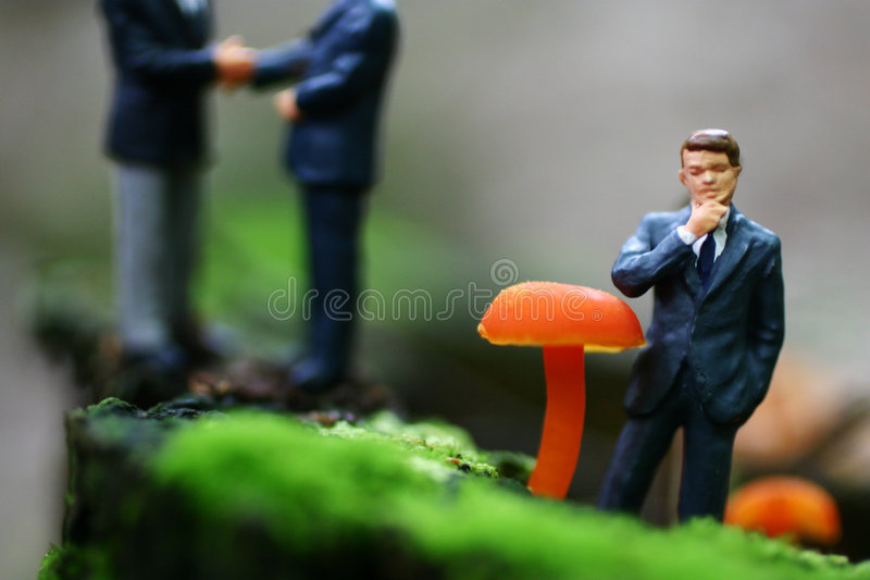 Doing business. A business man considers a newly made partnership stock photography