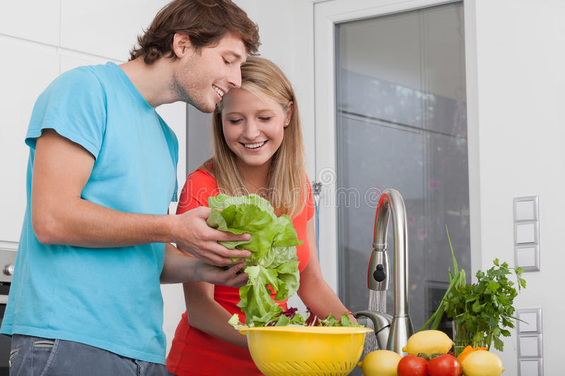Doing diet lunch. Couple doing diet lunch with different vegetables stock photo