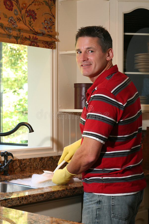 Doing the dishes stock images