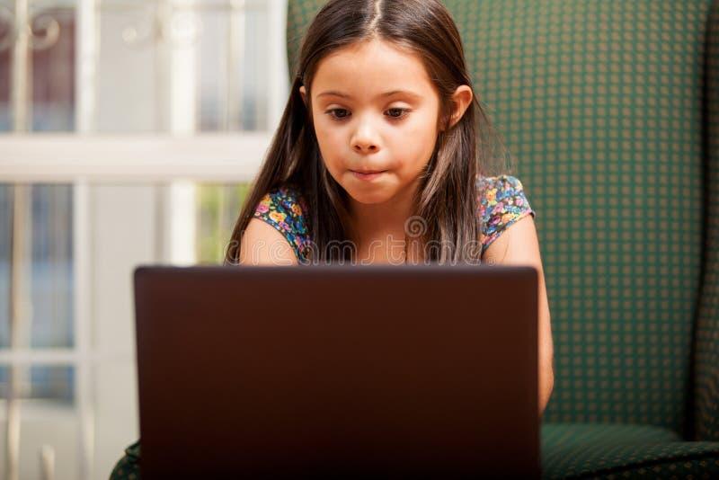 Download Doing homework on a laptop stock image. Image of hispanic - 34083389
