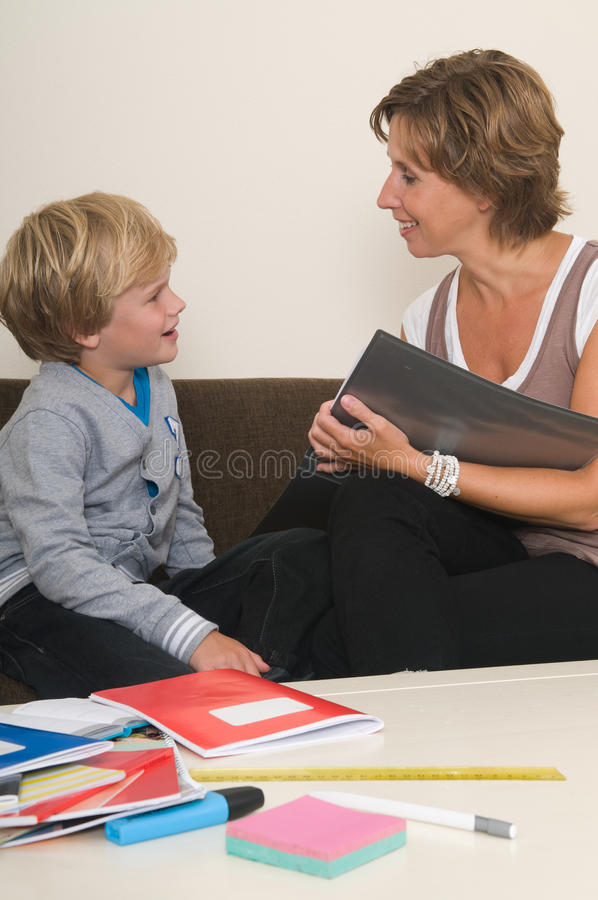 Doing homework with mother stock photo