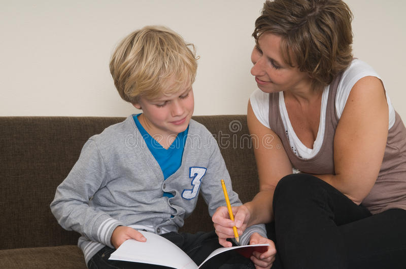 Doing homework with mother royalty free stock photo