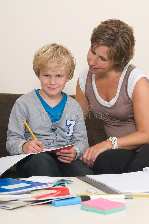 Doing homework with mother stock images