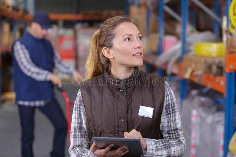 Doing inventory in warehouse royalty free stock photography