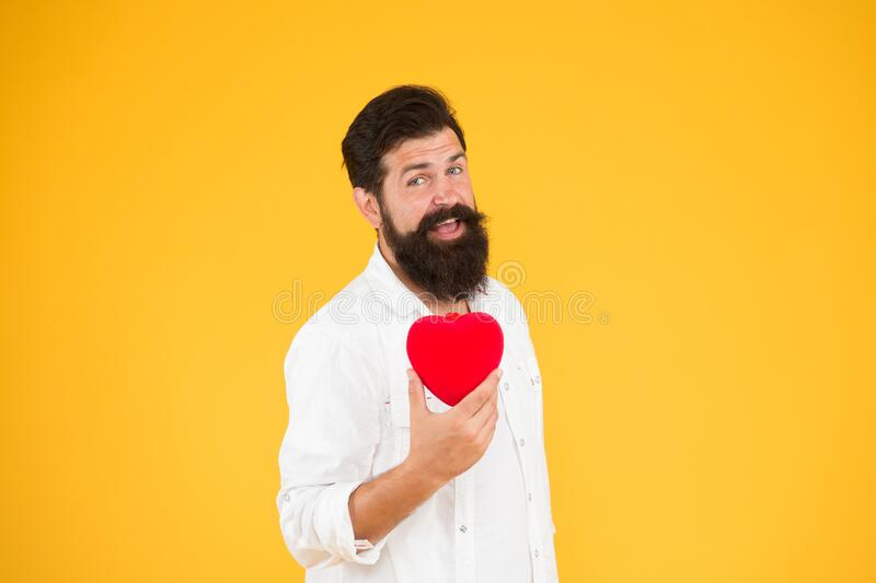 Doing more physical activity quitting smoking reducing amount alcohol. Healthy heart. Man bearded hipster hold red heart. Health care concept. Check helps stock photo