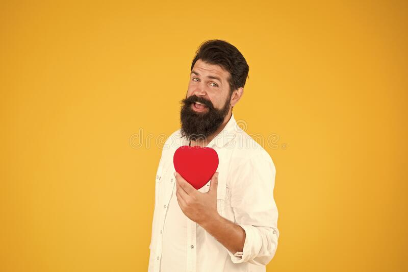 Doing more physical activity quitting smoking reducing amount alcohol. Healthy heart. Man bearded hipster hold red heart. Health care concept. Check helps royalty free stock photos