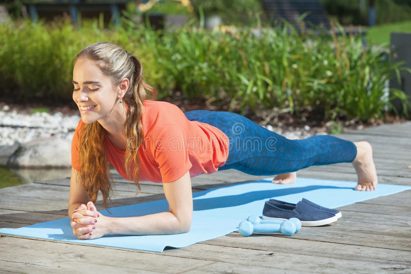 Download Doing Plank Outdoors Stock Photo - Image: 76723138