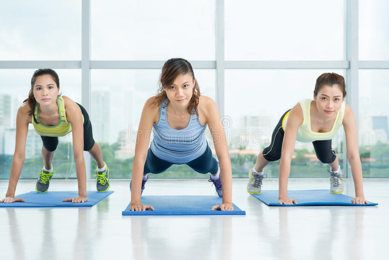 Doing press-ups stock images