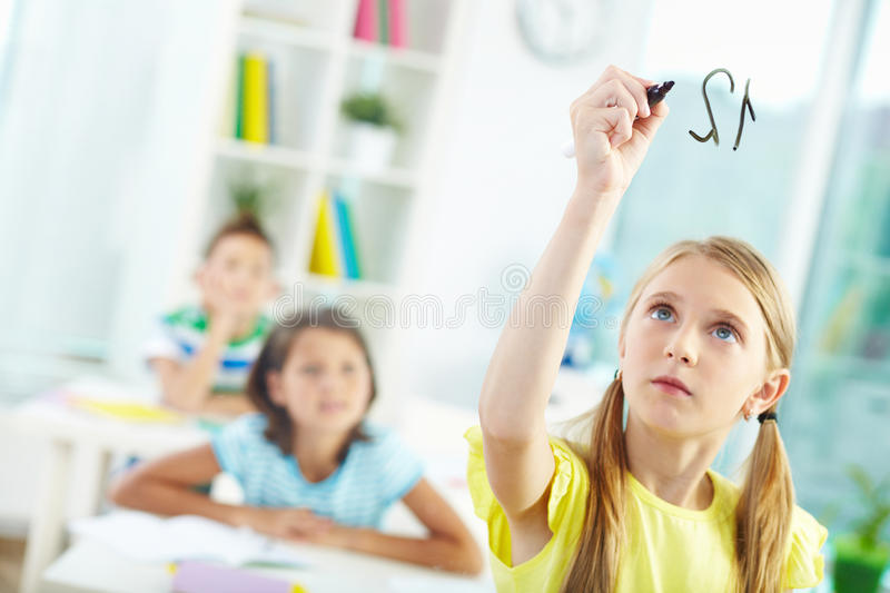 Doing sums stock images