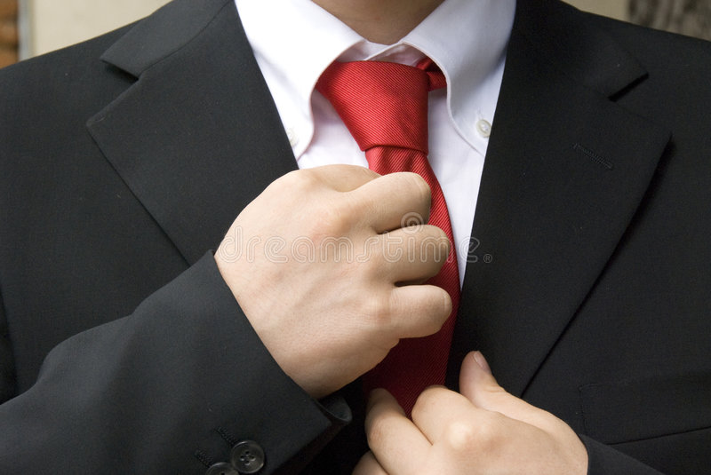 Doing a tie royalty free stock images