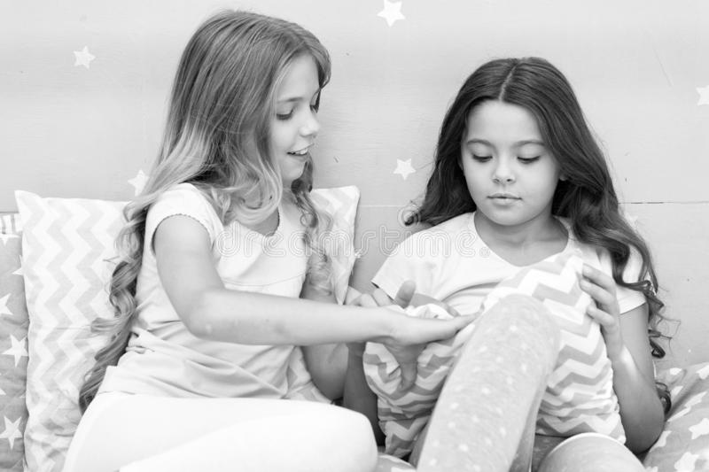 Doing whatever they want. Girls sleepover party ideas. Soulmates girls having fun sleepover party. Girls happy friends. With cute pillows. Pillow fight pajama stock image