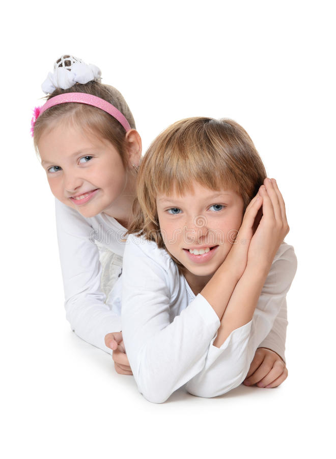 Dois amigos da rapariga no branco fotografia de stock