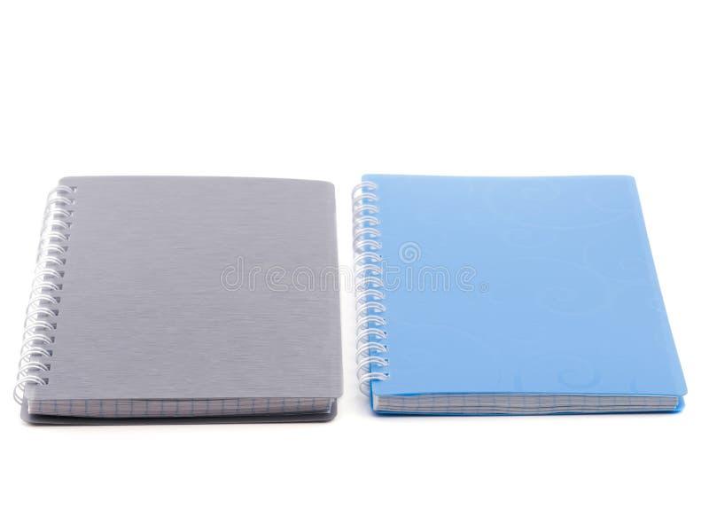 Dois blocos de notas em uma mesa branca fotografia de stock