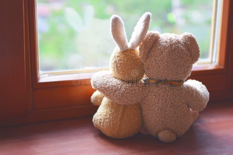 Dois brinquedos do luxuoso na soleira imagem de stock royalty free