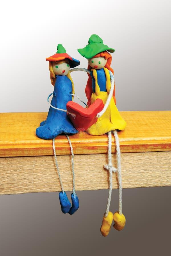 Dois caráteres cómicos feitos da argila e da corda imagem de stock