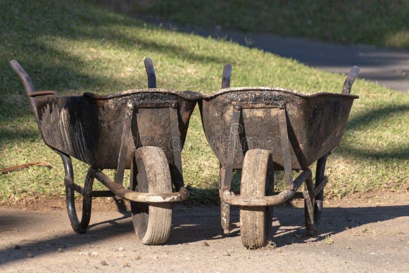 Dois carrinhos de m?o de roda fotos de stock