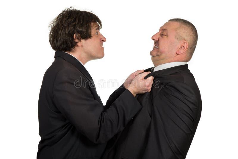 Dois colegas irritados do negócio durante um argumento, isolado no fundo branco fotos de stock royalty free