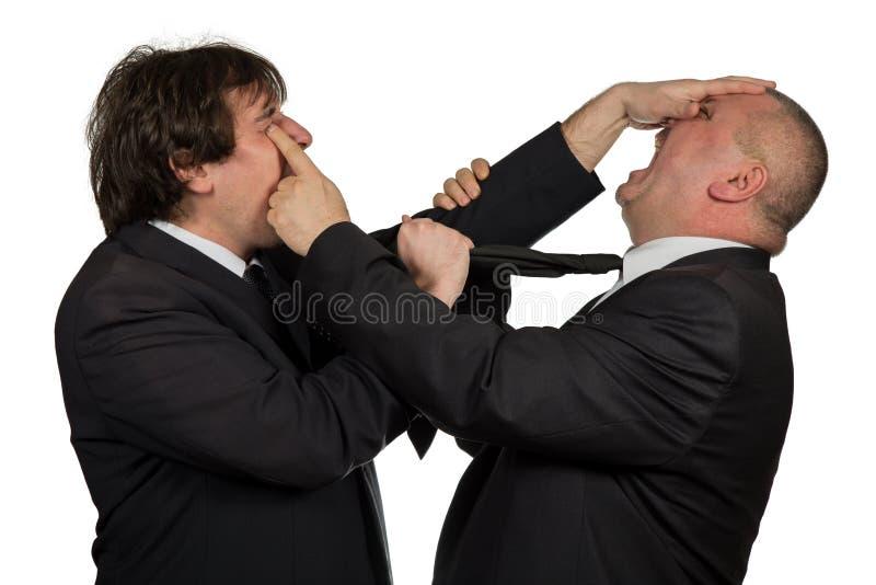 Dois colegas irritados do negócio durante um argumento, isolado no fundo branco fotografia de stock royalty free