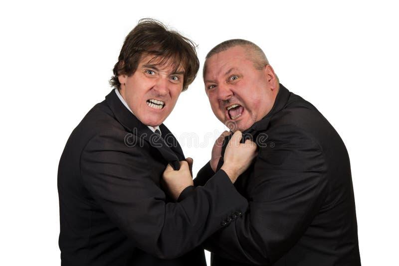 Dois colegas irritados do negócio durante um argumento, isolado no fundo branco imagens de stock royalty free