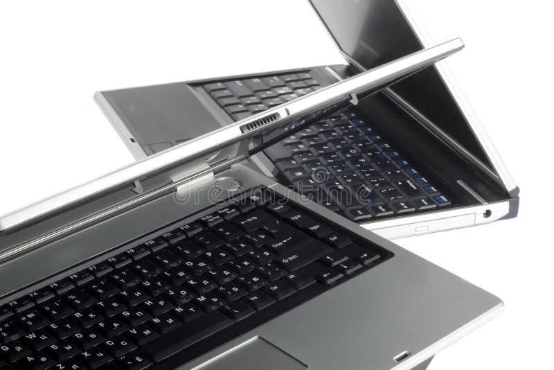 Dois computadores portáteis de prata foto de stock royalty free