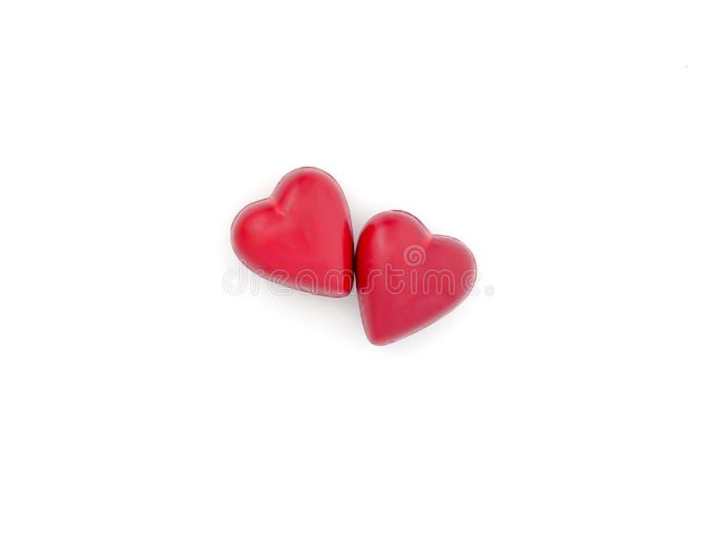 Dois corações feitos do chocolate escuro fotografia de stock