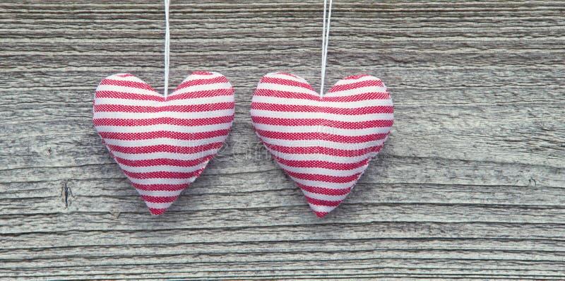 Dois corações listrados da tela fotografia de stock royalty free