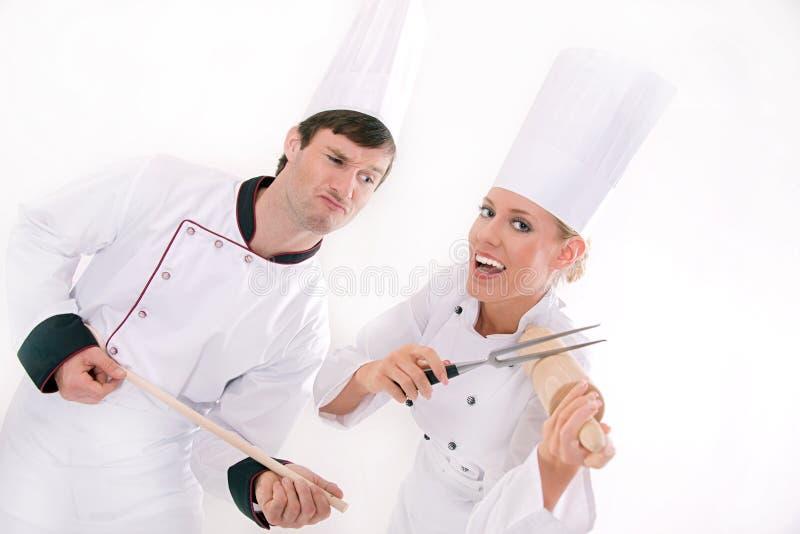Dois cozinheiros chefe felizes imagem de stock royalty free