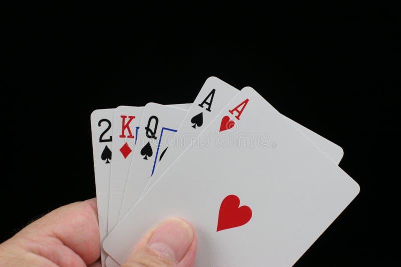 Dois de uma mão de póquer amável. imagem de stock