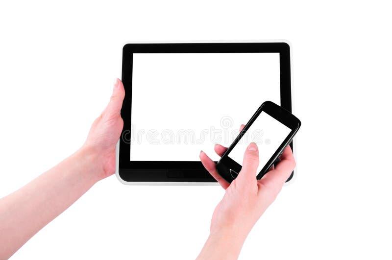 Dois dispositivos nas mãos fotografia de stock