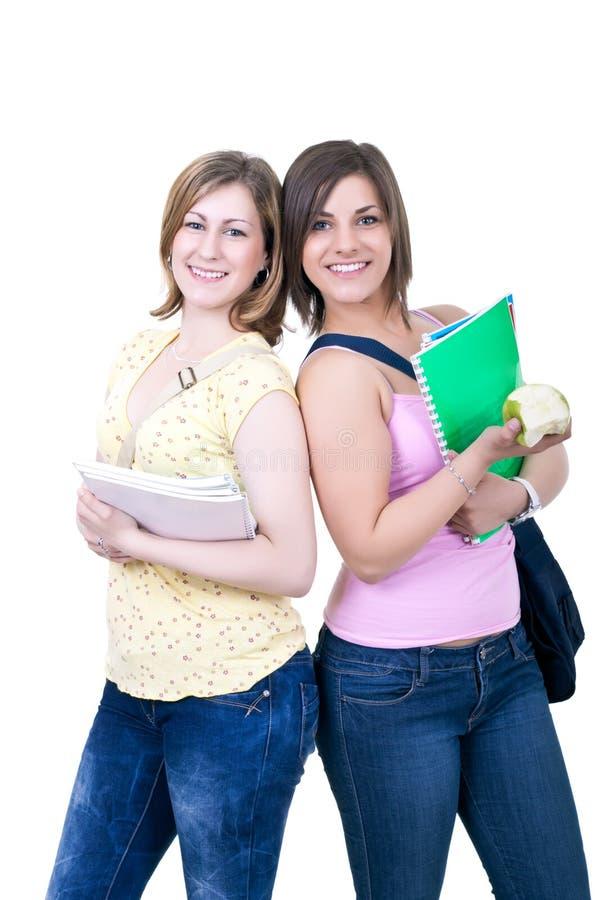 Dois estudantes com livros e maçã foto de stock