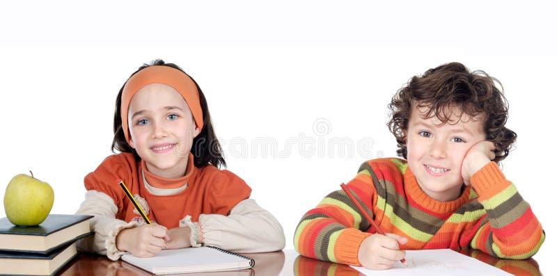 Dois estudantes dos irmãos imagens de stock royalty free