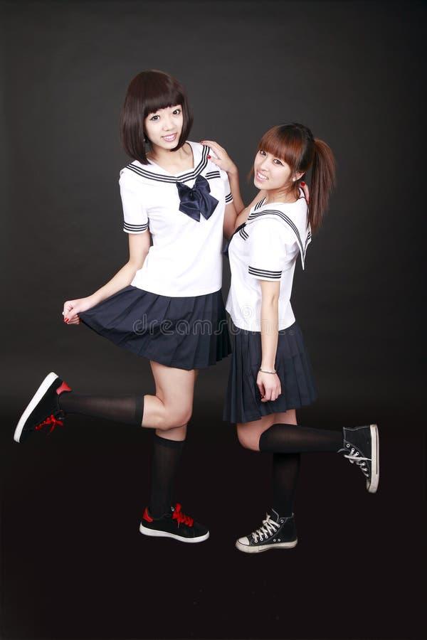 Dois estudantes fêmeas asiáticos imagens de stock royalty free