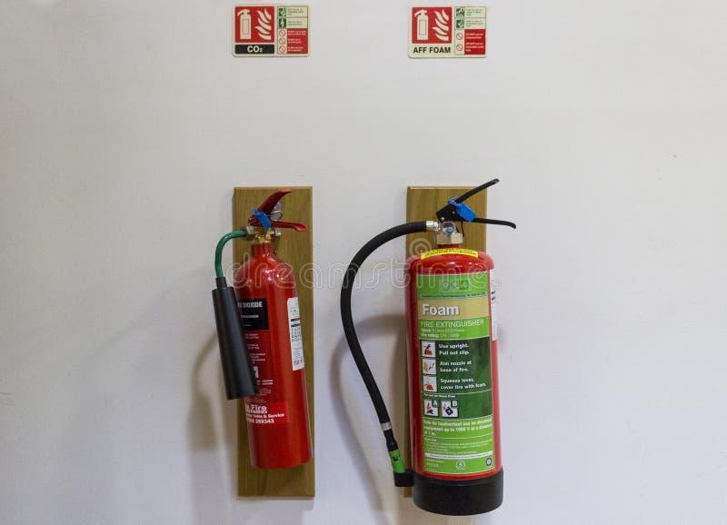 Dois extintores fotografia de stock