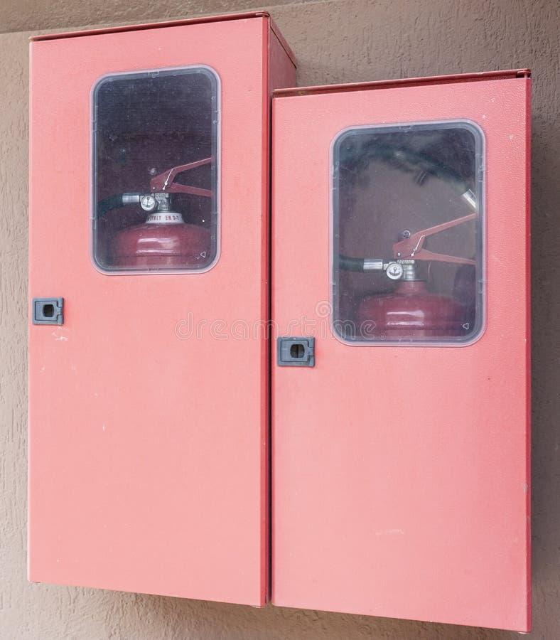 Dois extintores em seus cacifos fotos de stock royalty free