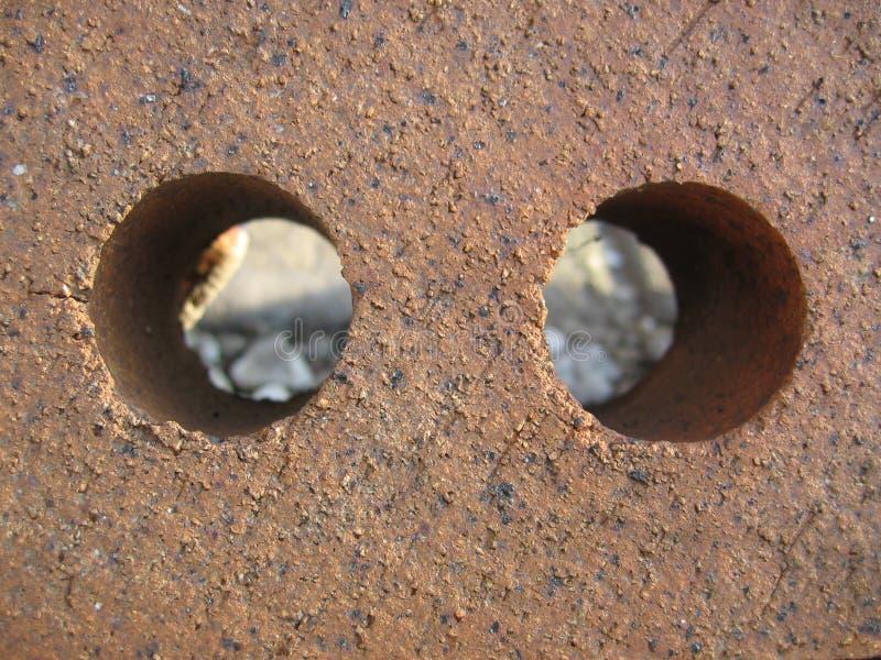Dois furos no sumário do tijolo imagem de stock
