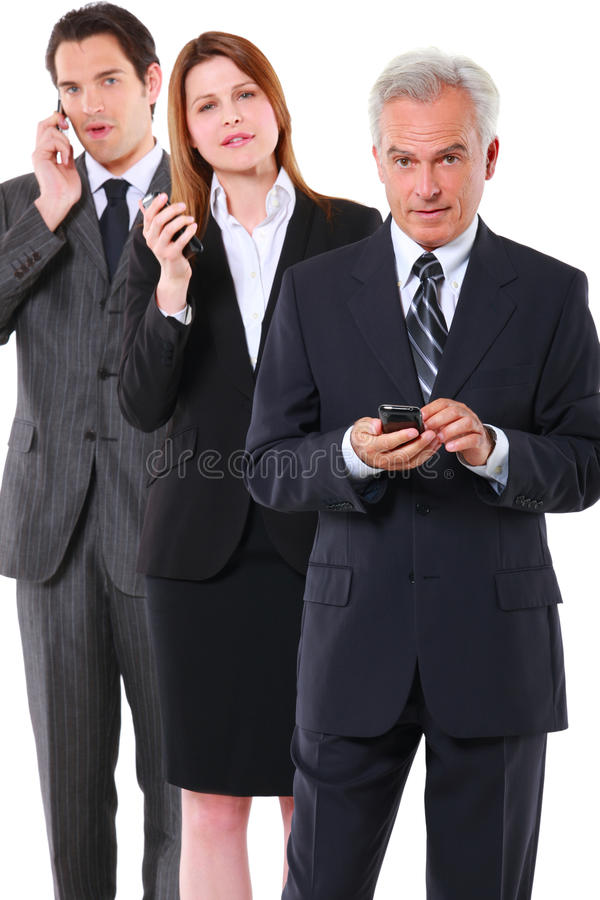 Dois homens de negócios e uma mulher de negócios com móbil fotografia de stock royalty free