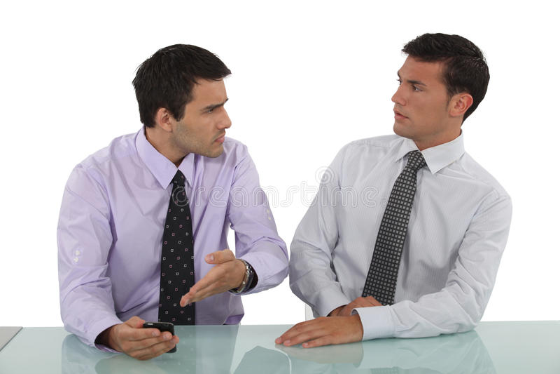 Dois homens de negócios que têm o argumento fotografia de stock royalty free